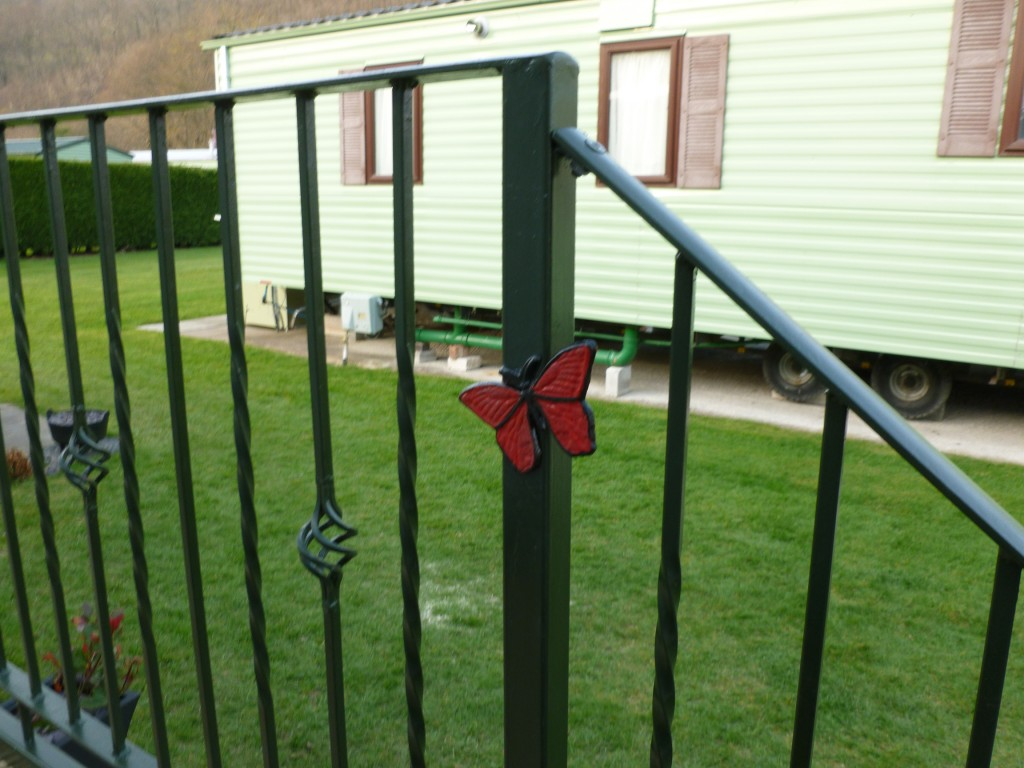 Butterfly Detail on Wrought Iron Caravan Balconies