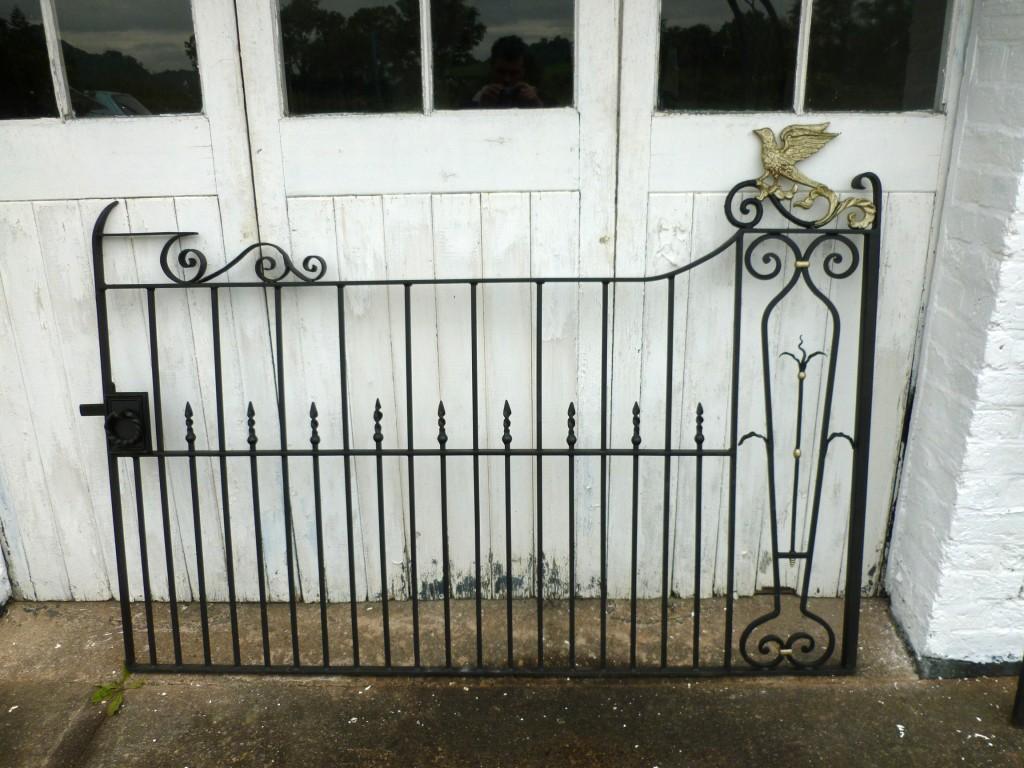 Ornate Wrought Iron Gates with Bird Design