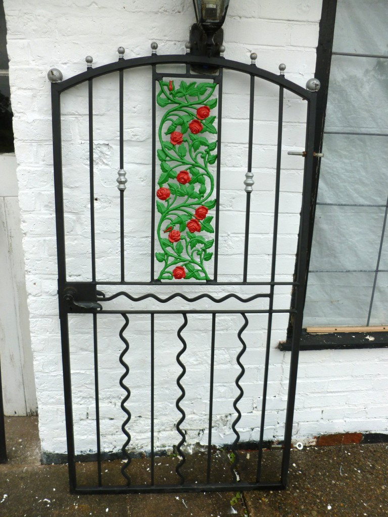 Ornate Wrought Iron Gates with inset Rose Design